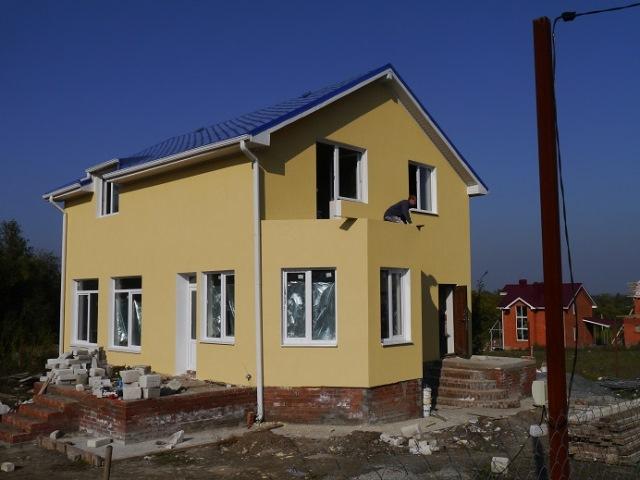Отделка фасадов домов плиткой с фото